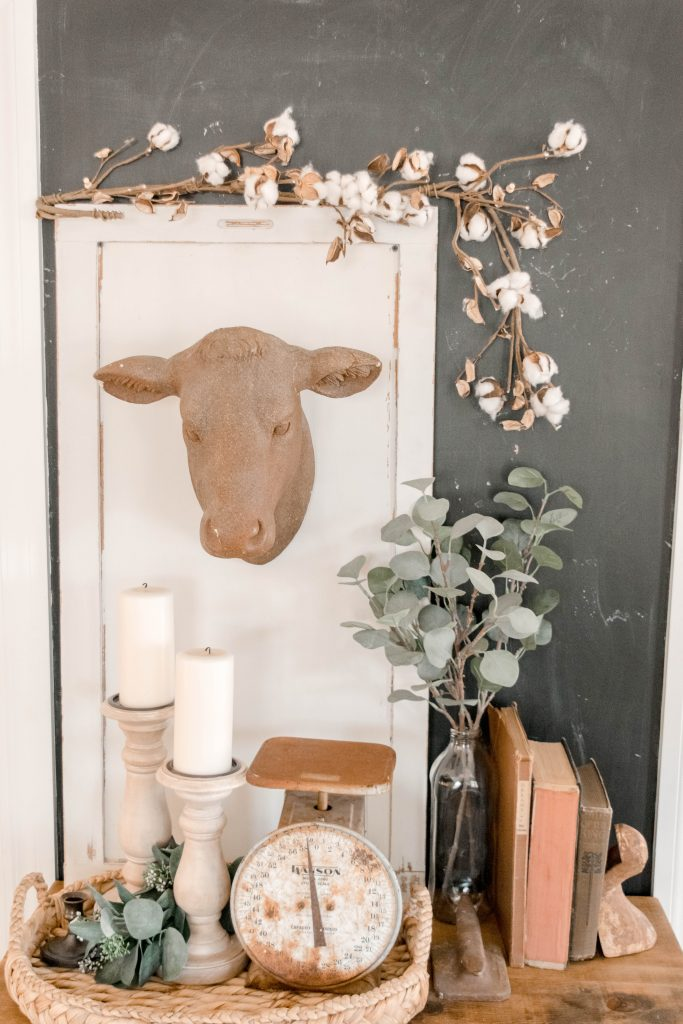 cow skull hanging with decor