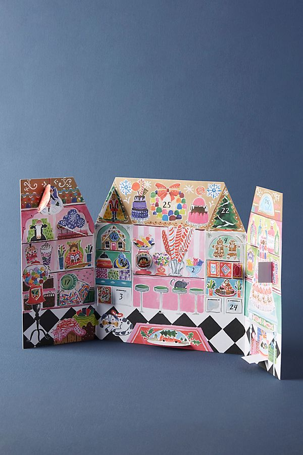 Crafted in the shape of a doll house and rendered in vibrant colors, this advent calendar offers numbered flaps that reveal a new, delightful illustration for each day leading up to Christmas.