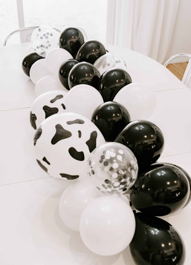 table runner balloons white and black holy cow first birthday