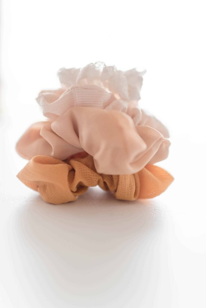 mustard, pink, mauve, white scrunchie in pile