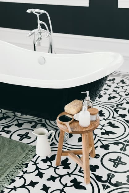 farmhouse tile in bathroom with claw foot tub