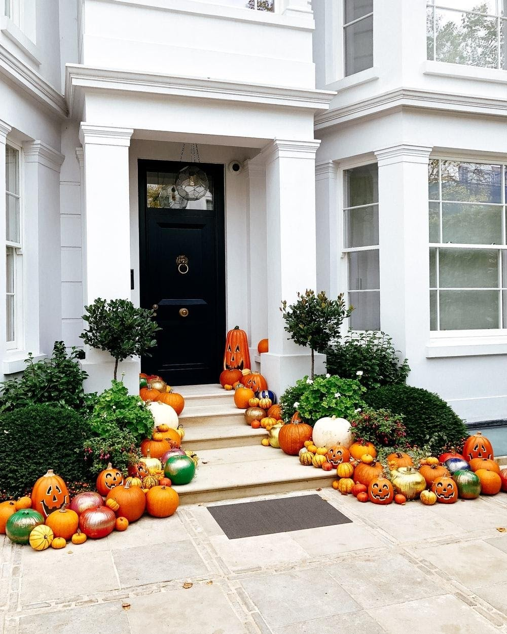 pumpkin decorations near house