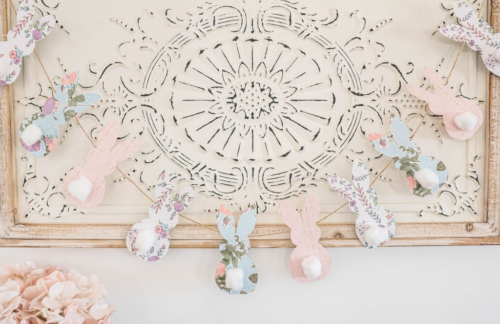 diy bunny garland hanging on wood sign