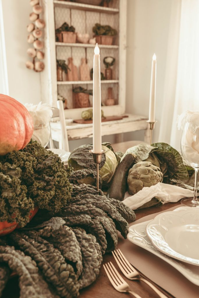 fall tablespace with vegetables and pumpkins on farmhouse dining room table